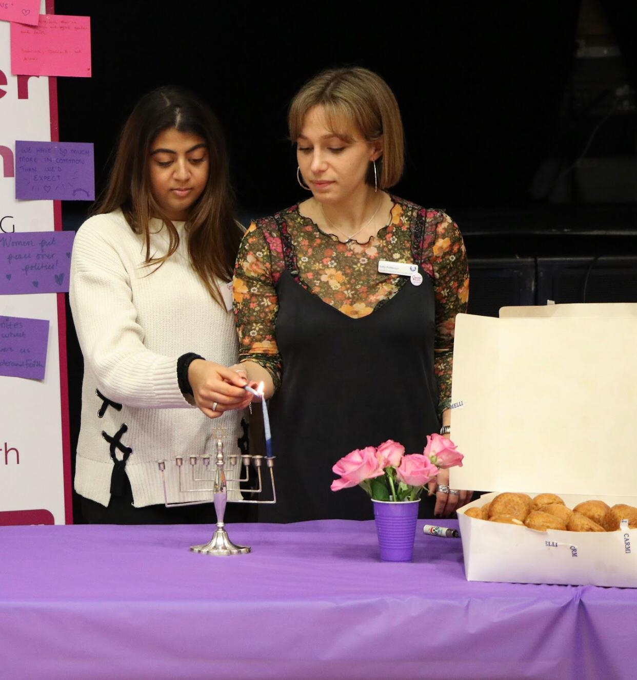 Organisers-Sally-Patterson-and-Saha-Habib-light-the-Chanukah-Menorah